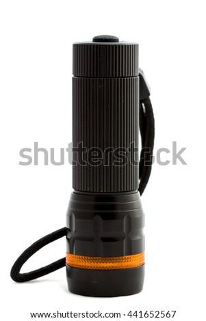 Black flashlight on white background. - stock photo