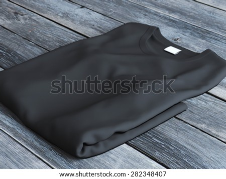 Black folded  t-shirt  - stock photo
