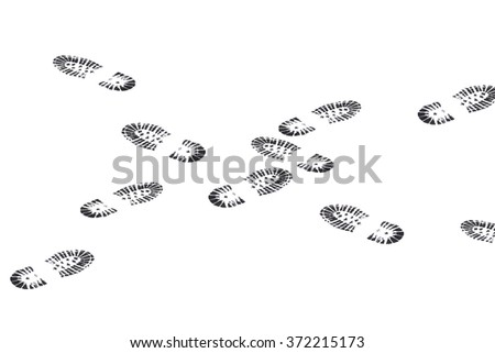 black footprints crossing one another - stock photo