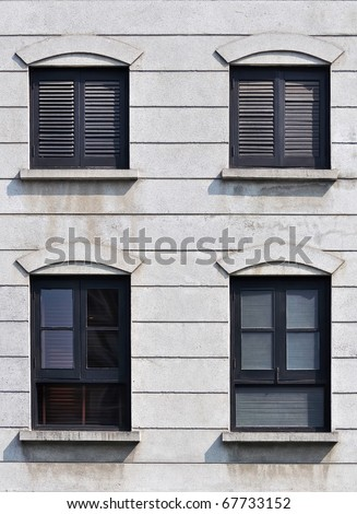 black frame and shuttered window - stock photo