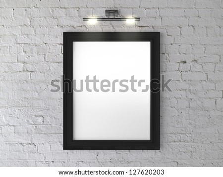 black frame on wall with wall lamp - stock photo
