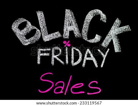 Black Friday sales advertisement handwritten with chalk on blackboard, Black Friday sale concept - stock photo