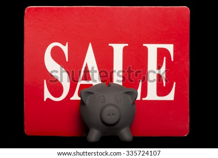 Black friday savings piggy bank sale cutout - stock photo