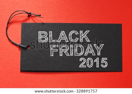 Black Friday 2015 text on a black tag on red colored background - stock photo