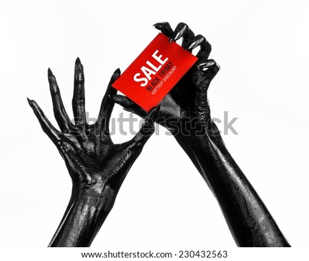 Black Friday theme: black hand holding a red card for a discount on white background - stock photo