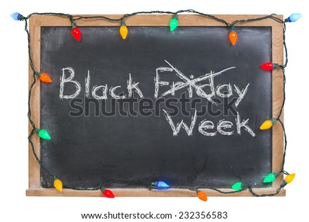 Black Friday Week with Friday x'd out written in white chalk on a black chalkboard surrounded with colored lights isolated on white - stock photo
