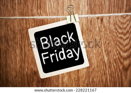 Black Friday written on a chalkboard with a wood background - stock photo