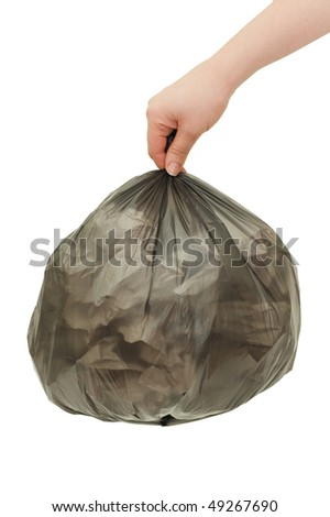 Black garbage bag In a female hand - stock photo