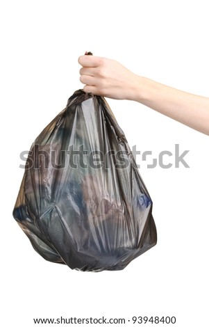 black garbage bag with trash in hand isolated on white - stock photo