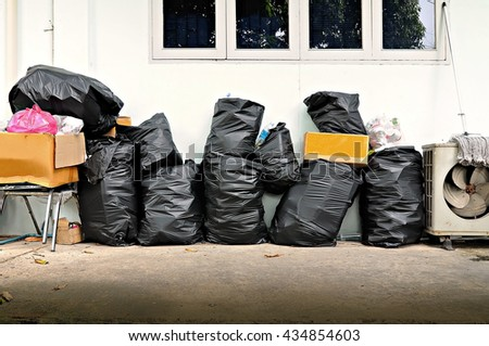 Black garbage bags and sold for recycling  - stock photo