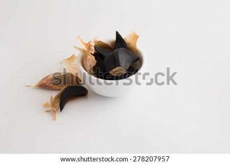 Black garlics 6 - stock photo