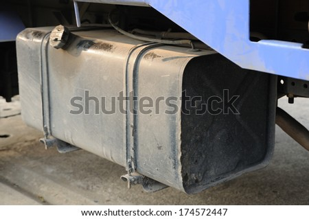 Black gasoline tank under truck. - stock photo