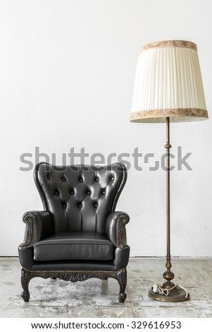 Black genuine leather classical style chair with lamp - stock photo