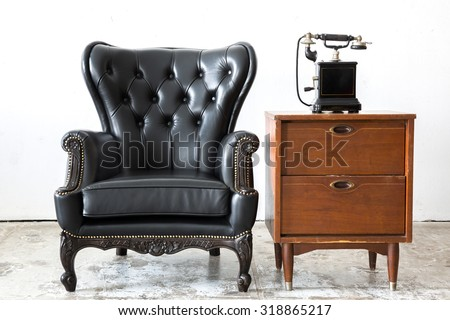 Black genuine leather classical style chair with side cabinet and telophone - stock photo