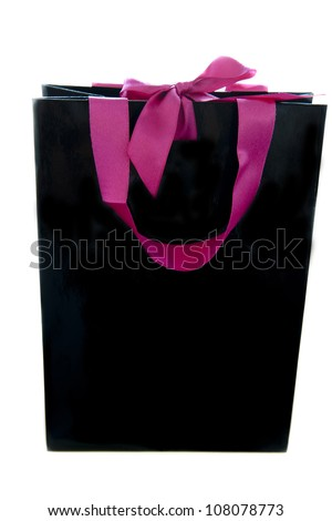black gift bag with pink ribbons on a white background - stock photo
