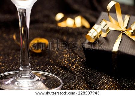 Black gift box on black shiny background. Celebration - stock photo