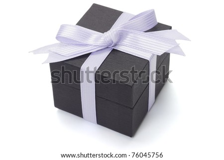 Black gift box with bow ribbon on white background - stock photo