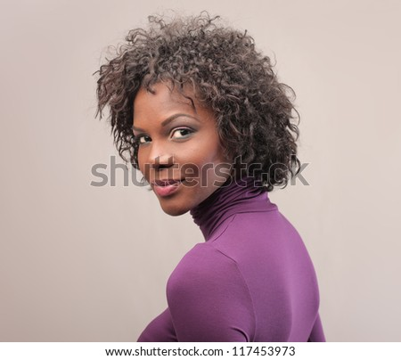 Black girl dressed in pink - stock photo