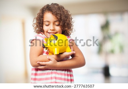 black girl with a piggy bank - stock photo