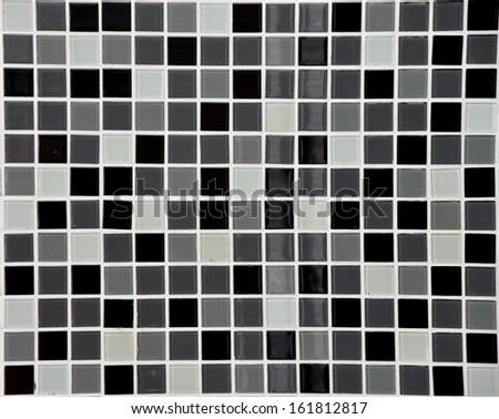 Black glass mosaic background - stock photo