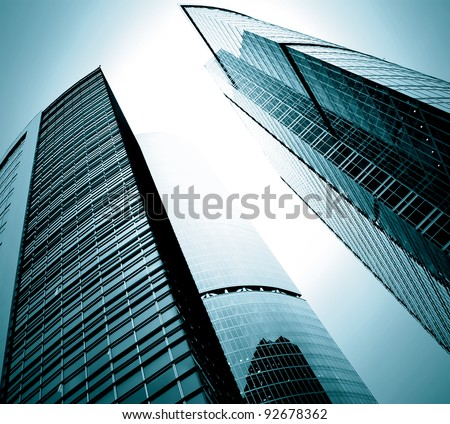 black glass silhouettes of skyscrapers at night - stock photo