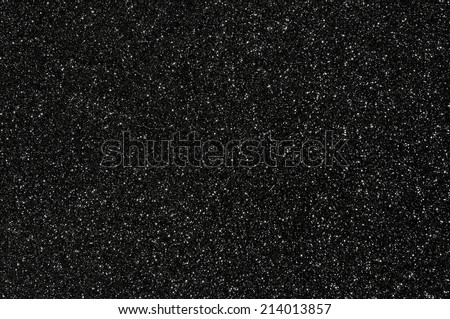 black glitter texture dark background - stock photo