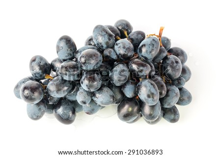 black grapes drops of water white background - stock photo