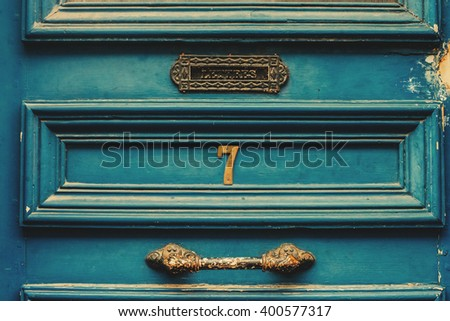 Black grey old wooden door detail with vintage handle and mailbox.  - stock photo
