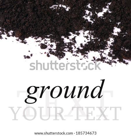 Black ground closeup isolated on white background - stock photo