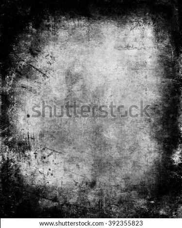 Black Grunge vintage scratched texture background with faded central area for your text or picture - stock photo