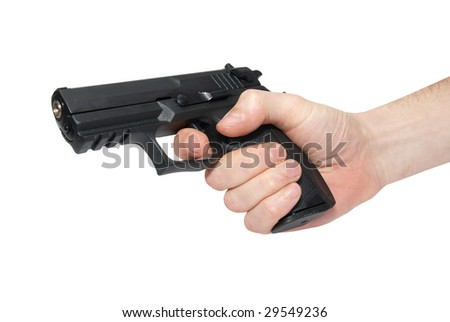 Black gun in a hand isolated on white - stock photo