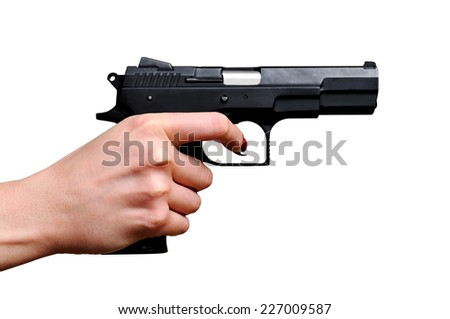 Black gun in a hand on the white background. Isolated on white - stock photo