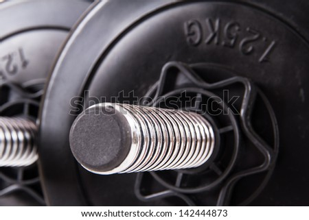Black gym barbell, dumbbell with disks. - stock photo