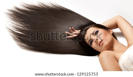 Black Hair. Beautiful Brunette with Long Hair. High quality image. - stock photo