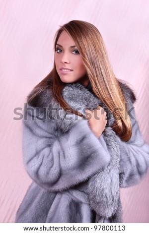 black hair beautiful woman in fur coat - stock photo