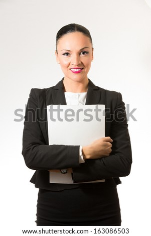 Black hair business dressed woman holding white book - stock photo