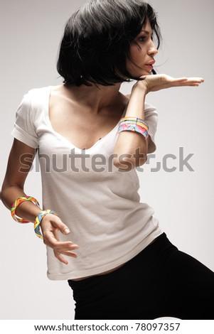 black hair woman dance, studio shot - stock photo