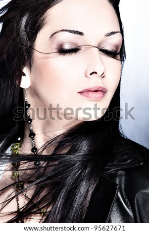 black hair woman portrait with eyes closed, studio shot - stock photo