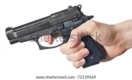 Black handgun in hand of a yong man. - stock photo