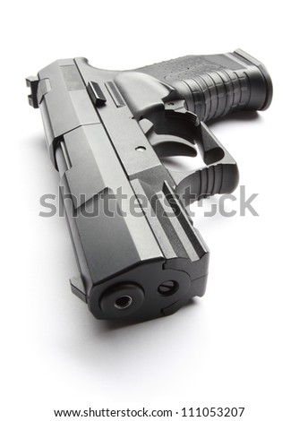 Black handgun isolated on a white background - stock photo