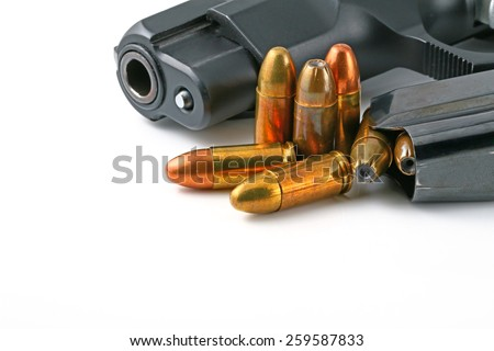 Black handgun isolated on a white background. - stock photo
