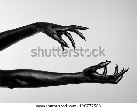 Black hands of death - stock photo