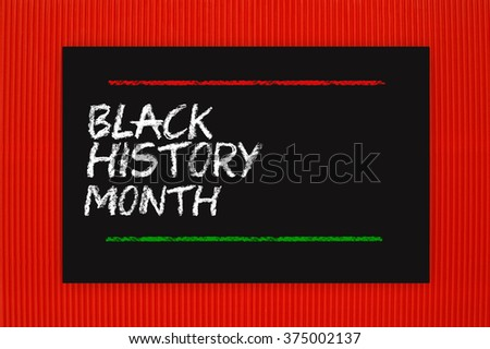 Black History Month Blackboard hanging on red textured background - stock photo
