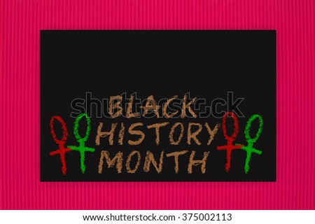 Black History Month Blackboard hanging on red textured background pattern - stock photo