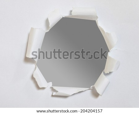 Black hole on white paper - stock photo