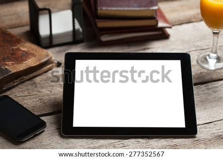 Black ipad on old wood table  - stock photo
