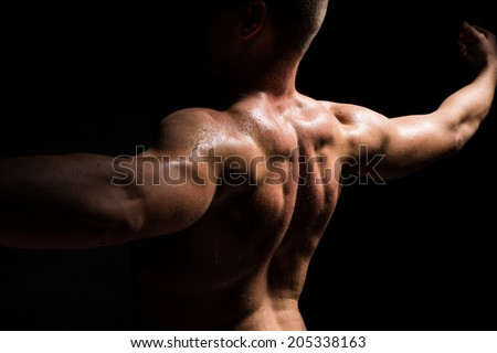 black isolated, muscle man - stock photo