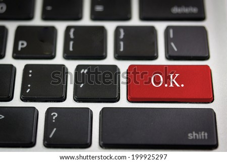 Black keyboard with word  O.K. on the red keyboard key - stock photo