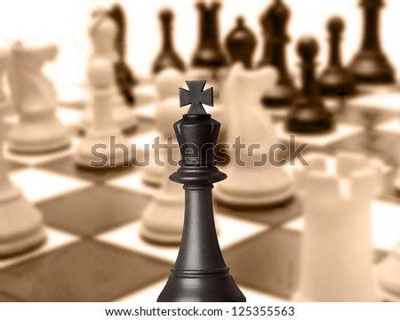 Black king chess piece in the chessboard - stock photo