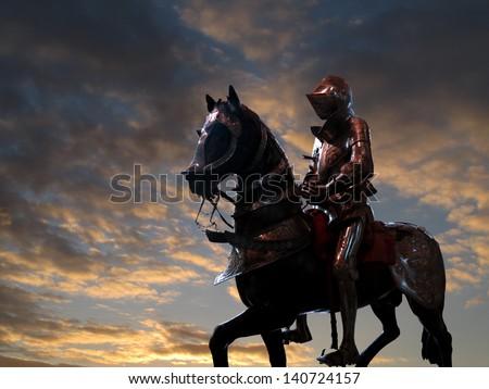 Black knight on horseback, against sunset - stock photo